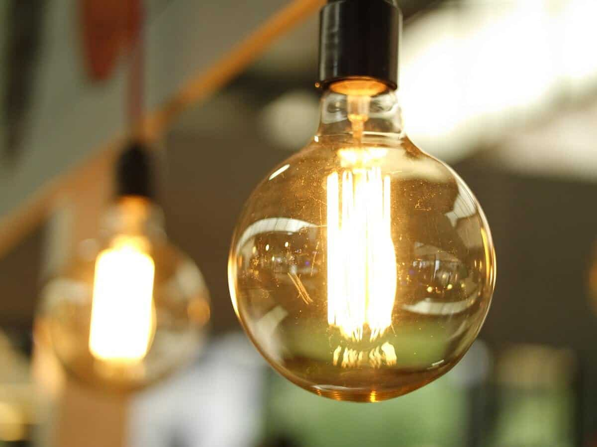 A close up of a clear glass bulb and the glowing light inside.