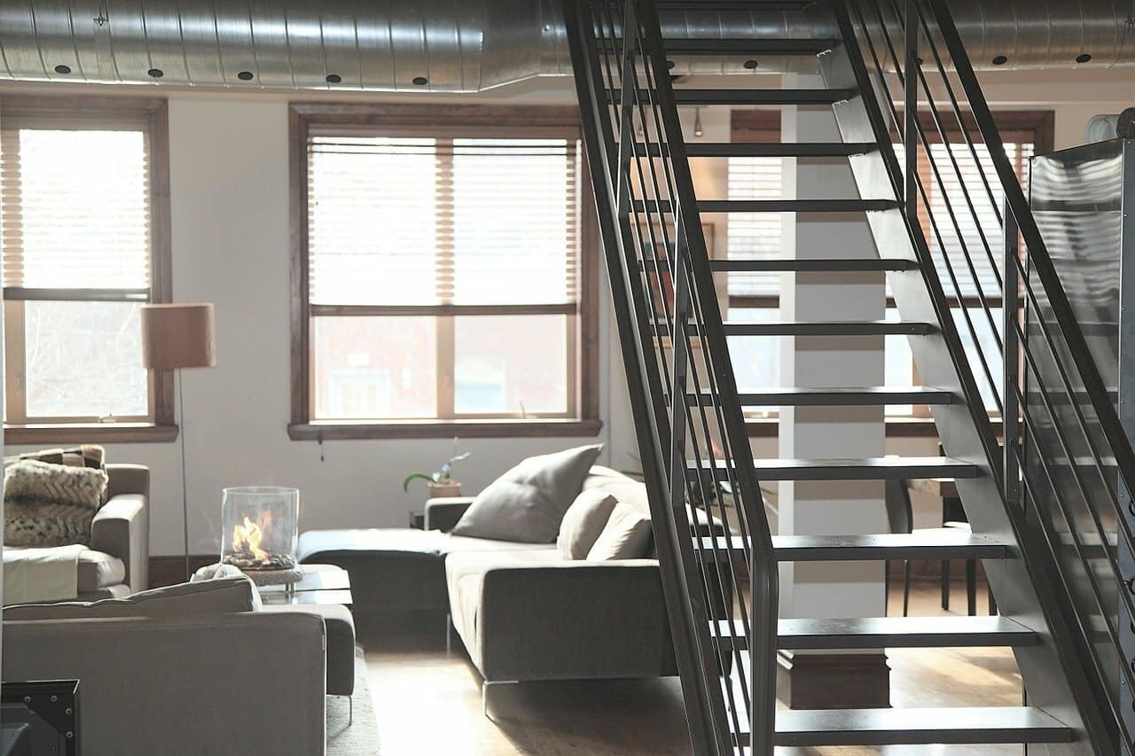 Industrial-style living area of an apartment unit.