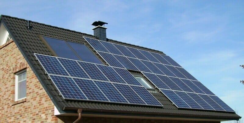 Solar panels installed on a brick suburban home.