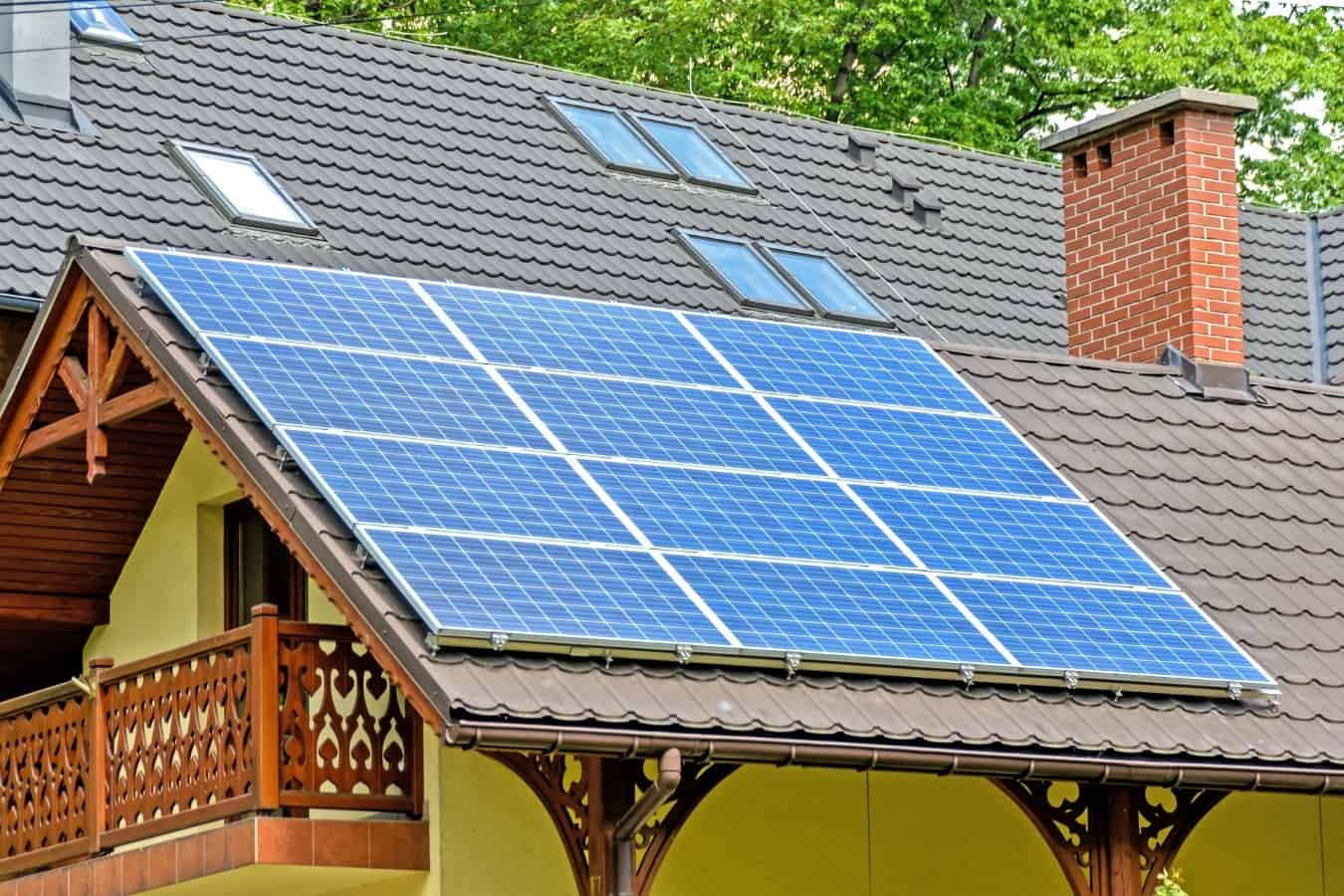 A solar panel grid installed on metal roof shingles.