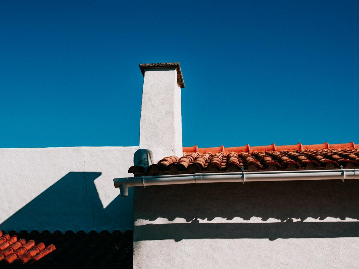 A Spanish style home with an orange tile roof.