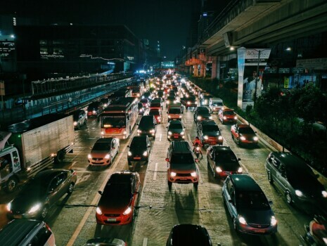 A traffic jam on a highway at night in a city.