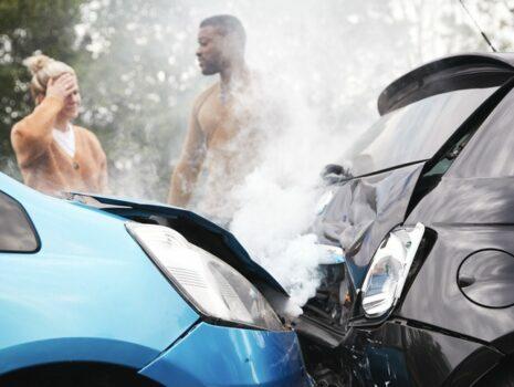 Blue car hit black car, two drivers talking