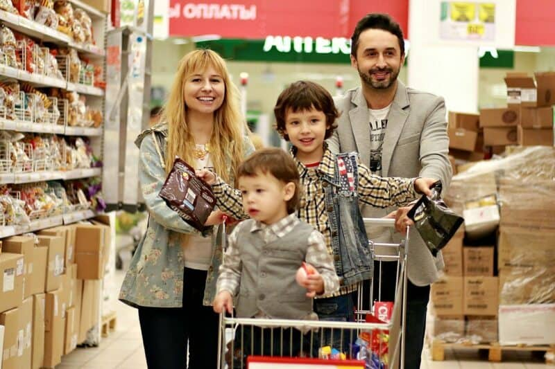 A young family shops in a grocery store.