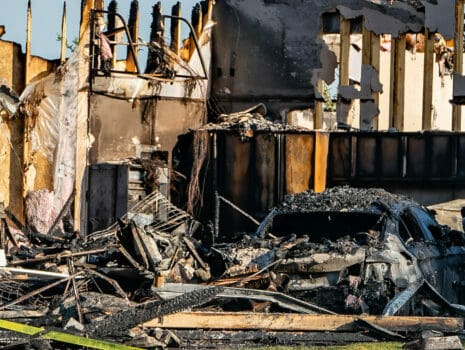 The aftermath of a home that has undergone extensive fire damage.