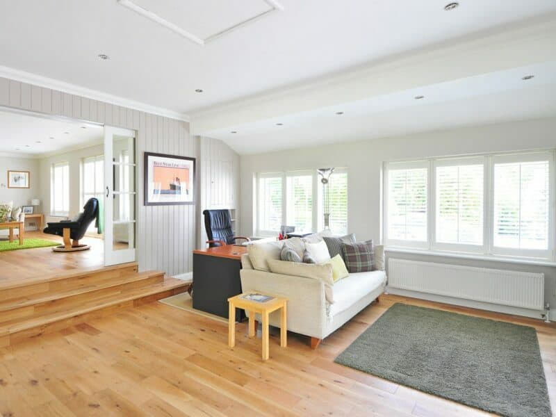 The tidy living room of a home with light brown floors.
