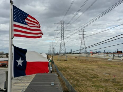 texas and american flag pointed towards electrical lines