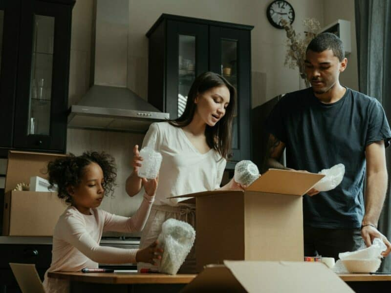 family unpacking in new home