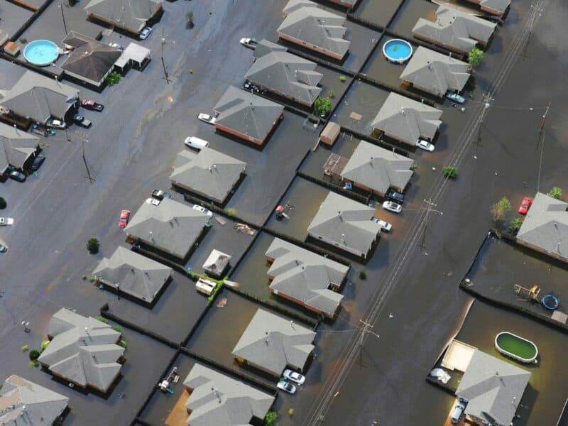 aerial image of multiple houses that are flooded