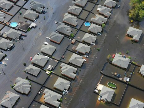 A bird's-eye view of a neighborhood flooded with water.