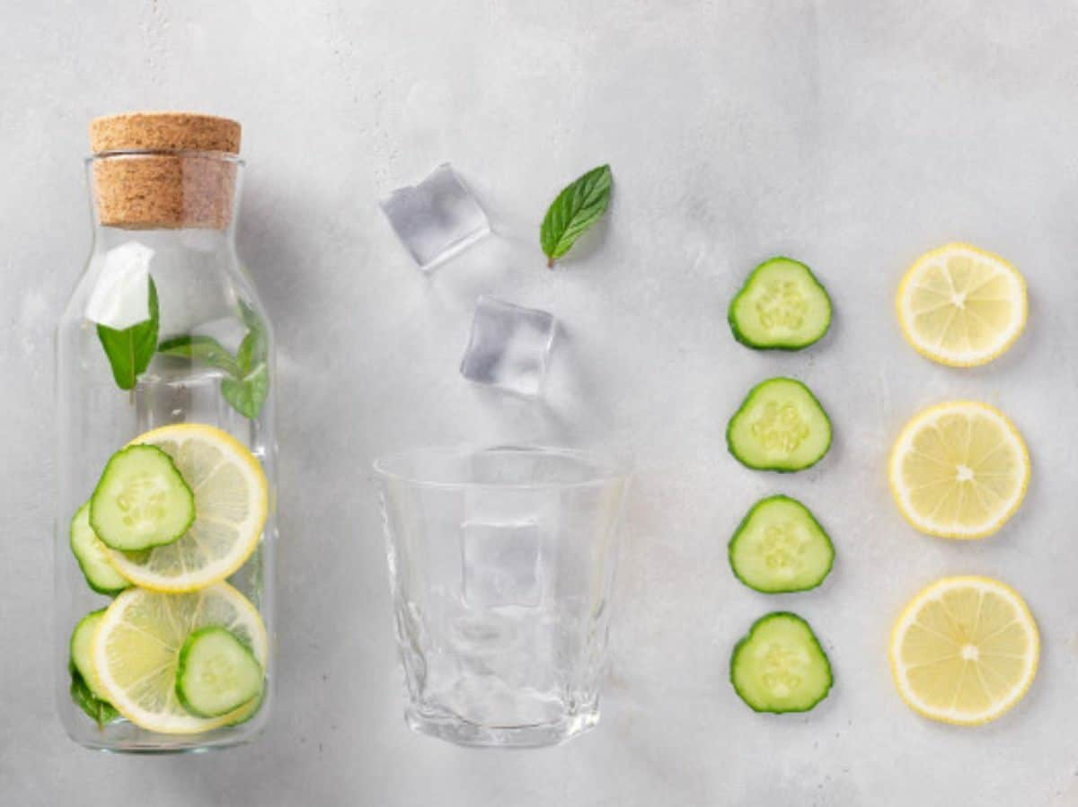 cucumber, lemon, ice, and water, with the pitcher on the very left