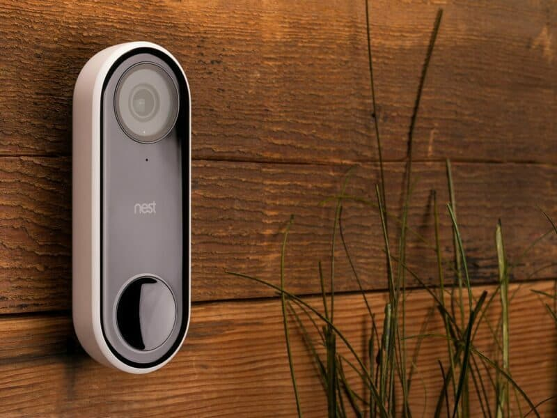 close up of the nest hello doorbell camera on wood wall
