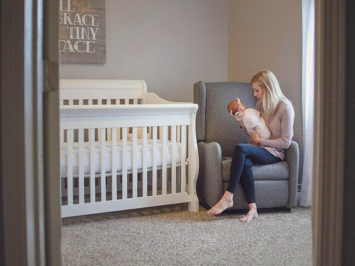 looking into a nursery with mother holding baby