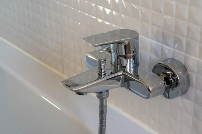 white backsplash, water faucet