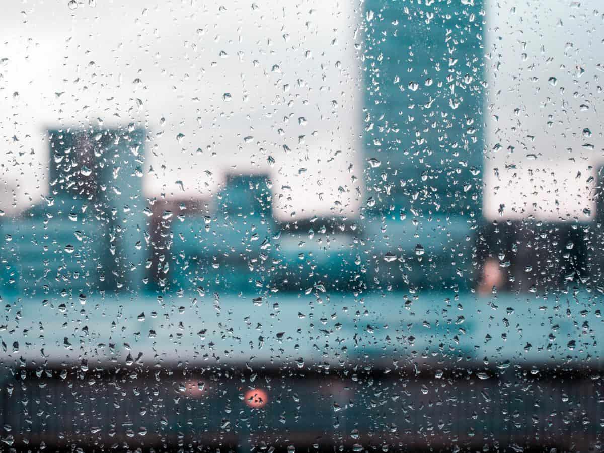 rainy day, rain on window facing buildings