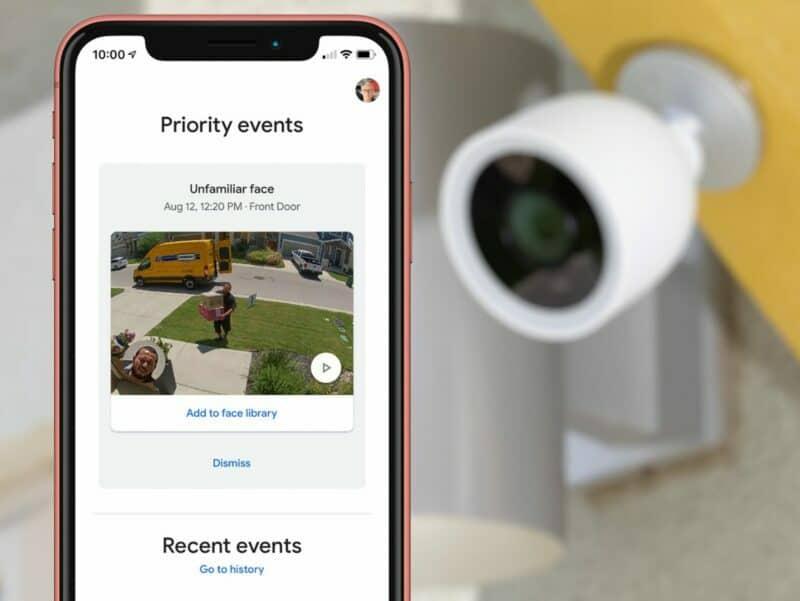 camera on yellow wall facing smart phone