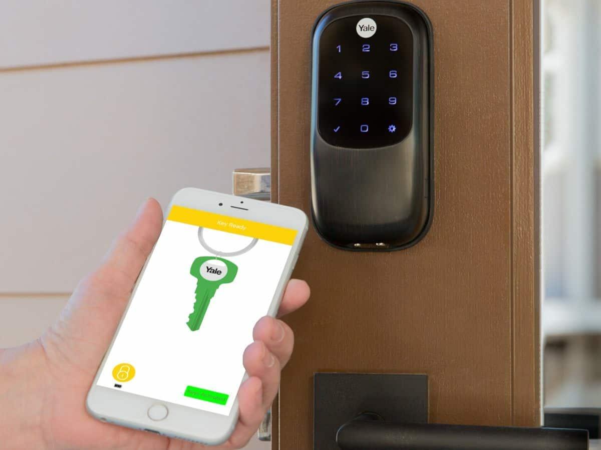 smart phone facing smart lock to unlock front door
