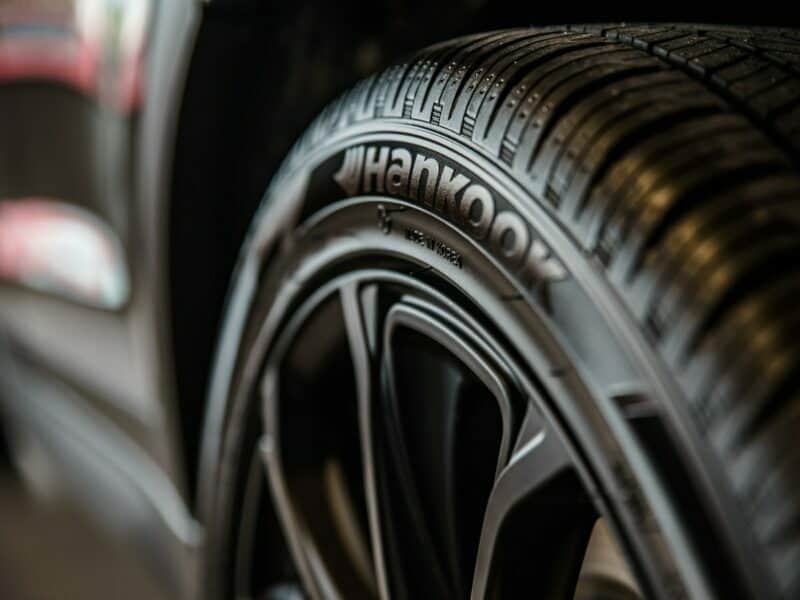 Close-up of shiny black tires on a vehicle.