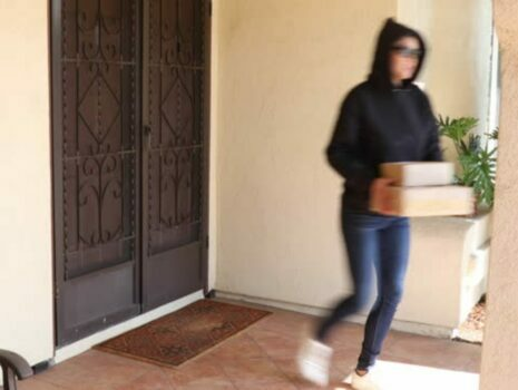 woman walking away with stolen package