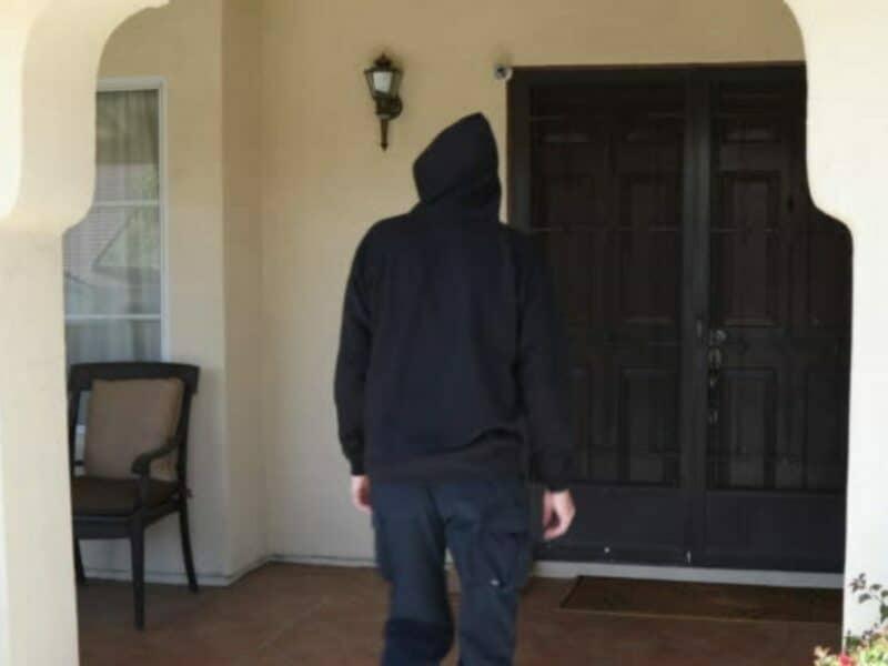walking up to door to steal package