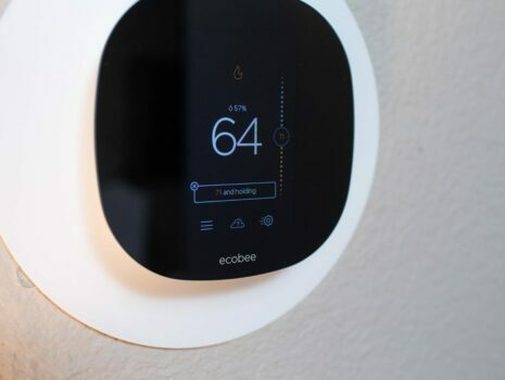 ecobee smart home thermostat showing 64 degrees