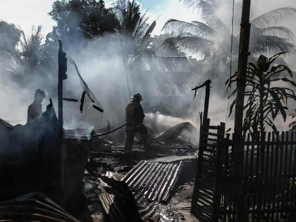 burned down home with smoke in the air