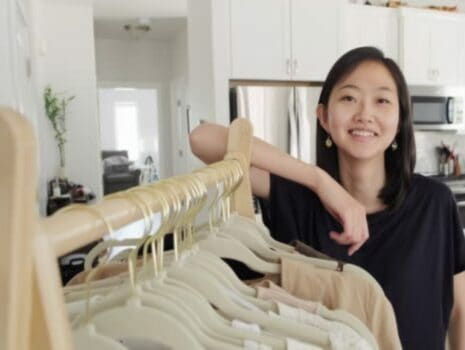 Woman working for clothes in a home boutique