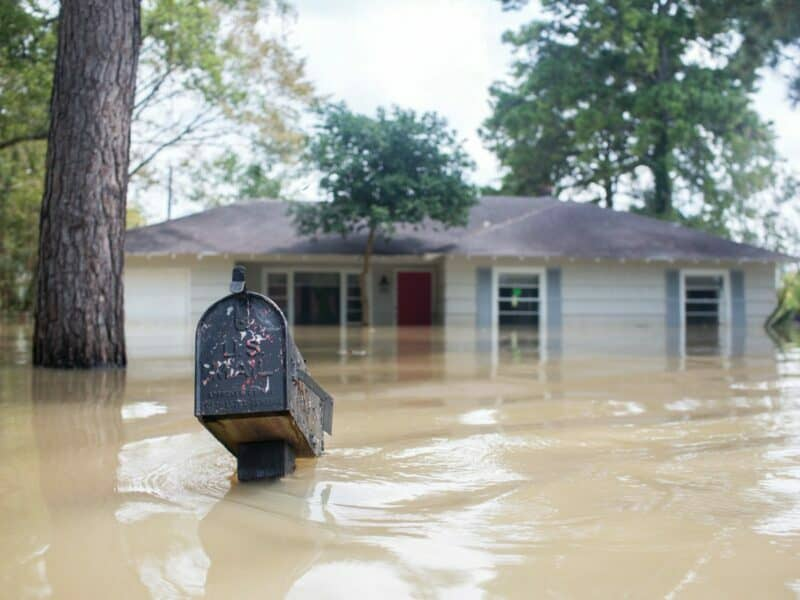 hurricane harvey flooded neighborhood with house and mailbox flooded