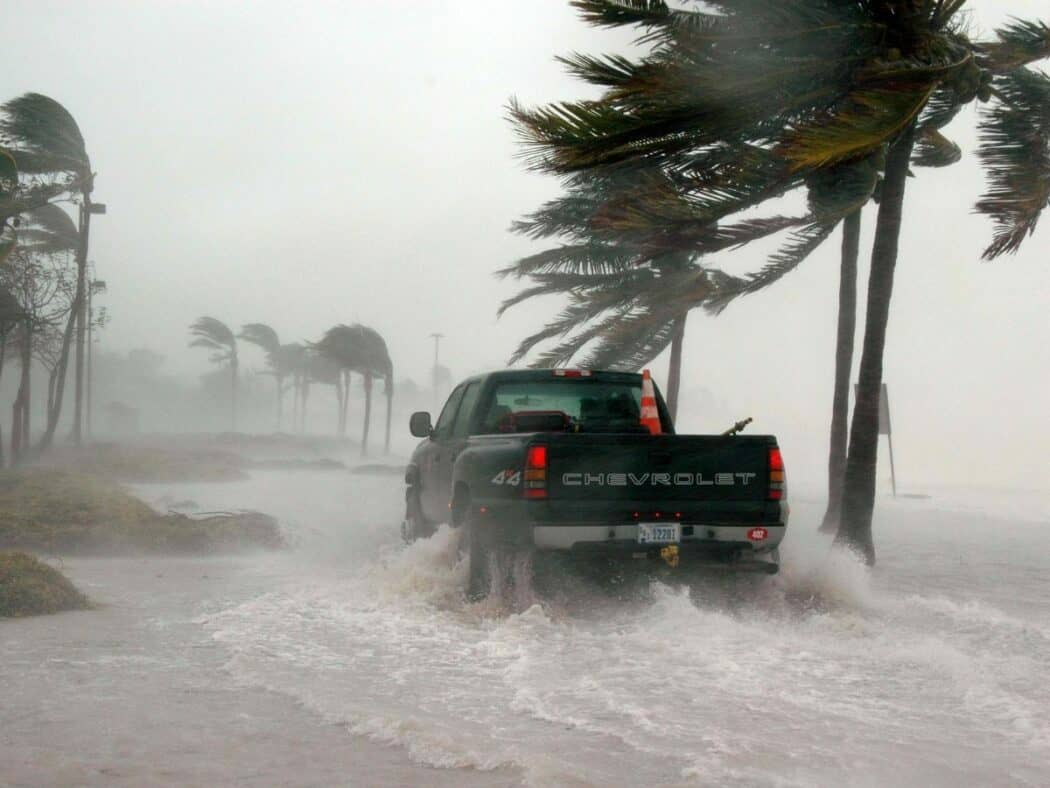 truck driving through flooded key west street