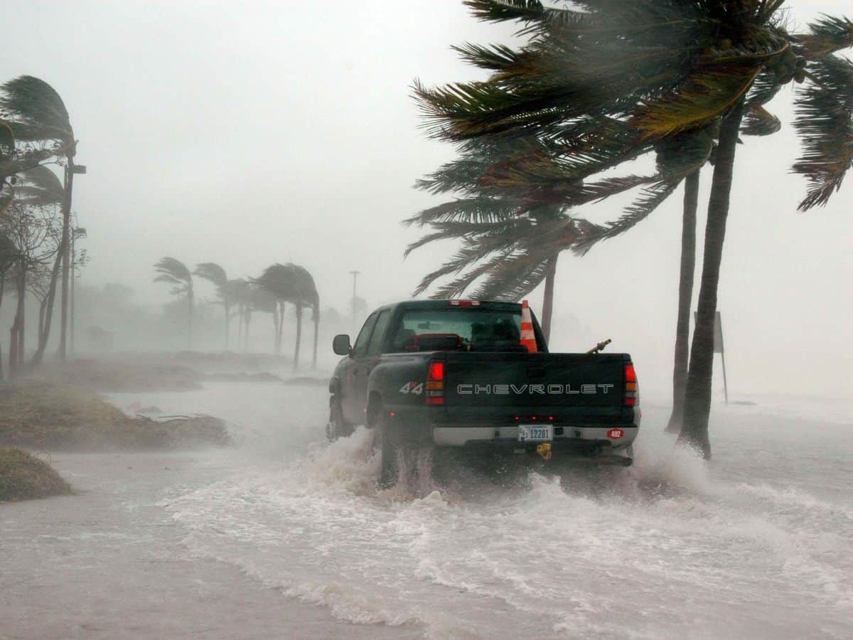 truck driving through flooded key west street