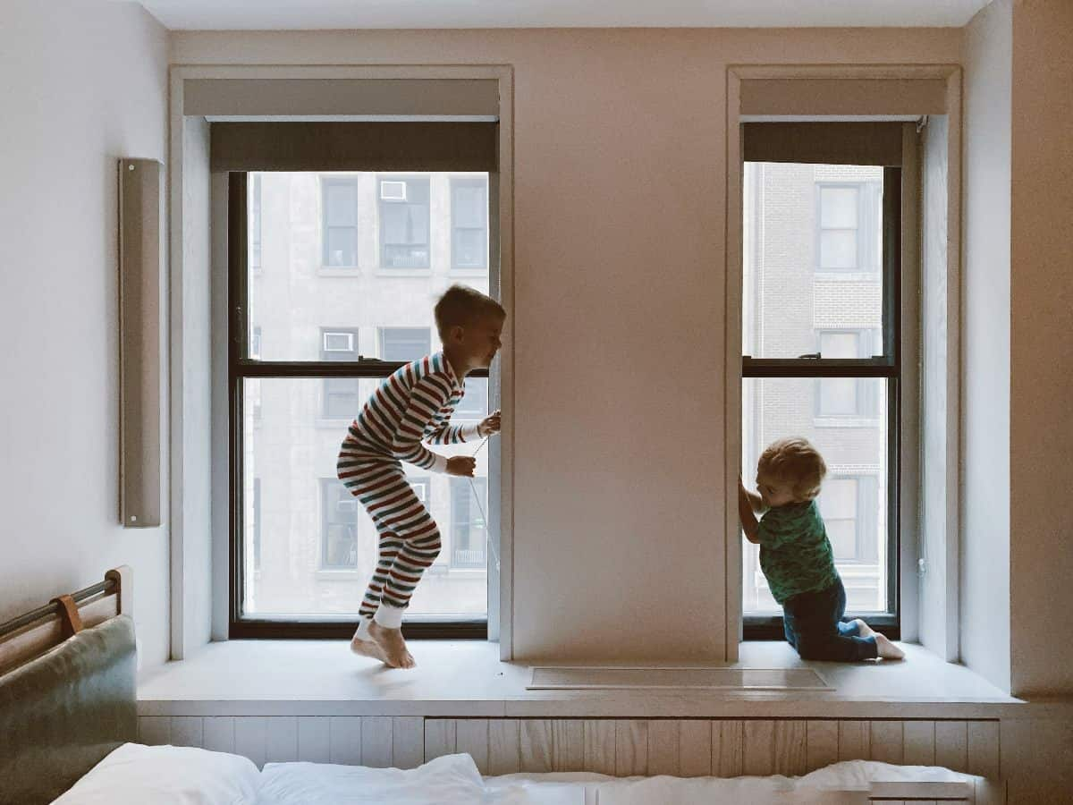 two kids in the window playing
