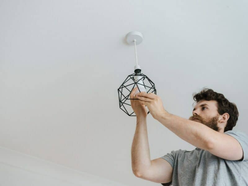 man installing light bulb into new feature