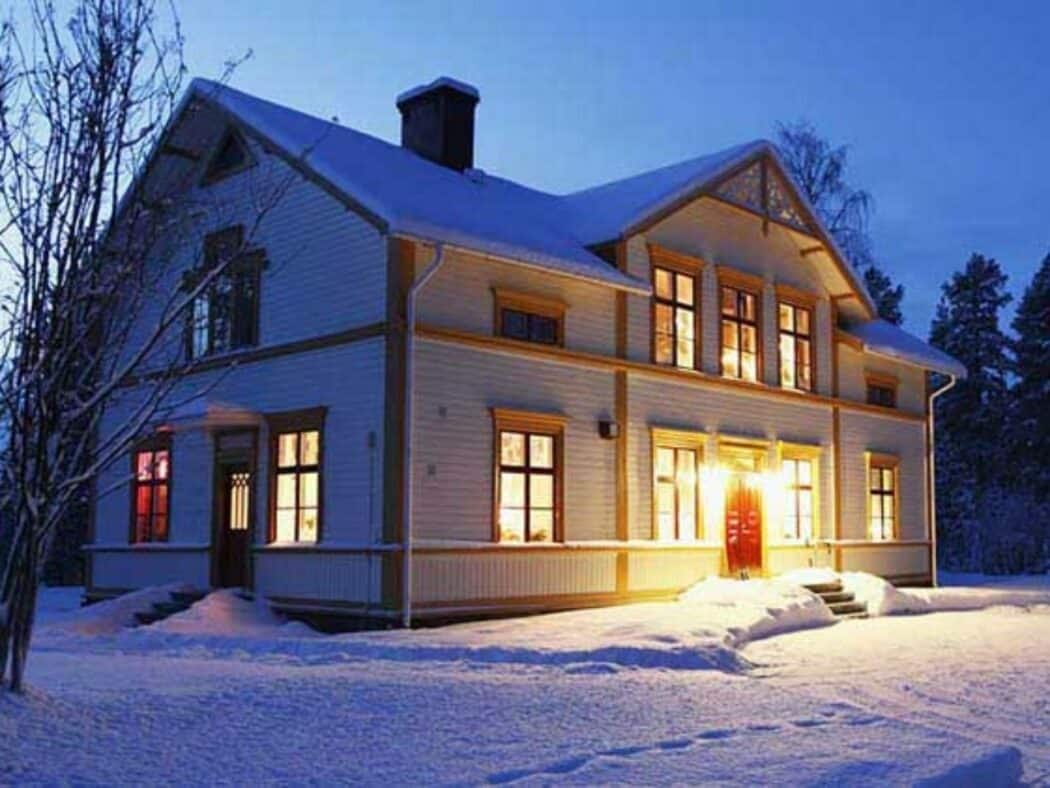 home during winter that is internally lit up