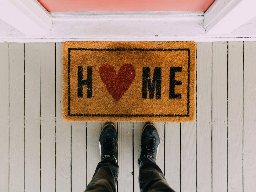 front porch doormat with pink front door