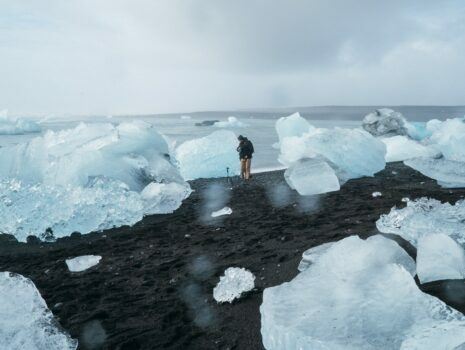 man standing in melted ice cap as a result of climate change