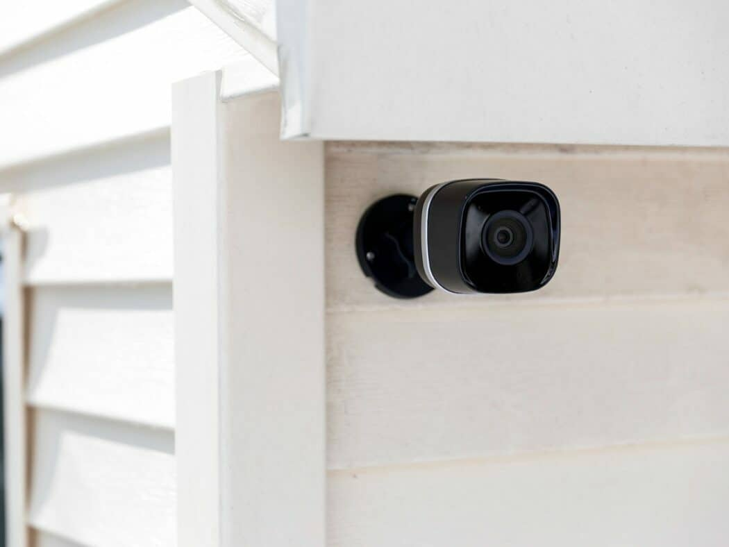 outdoor security camera system positioned on the house