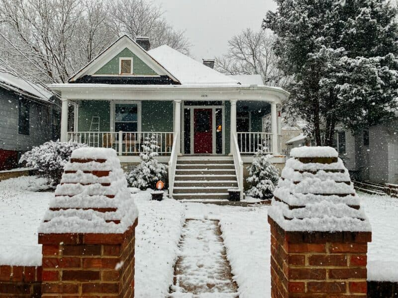sidewalk view of a house during cold weather