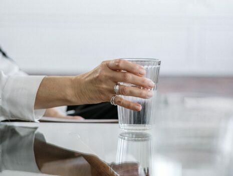 hand holding glass of water