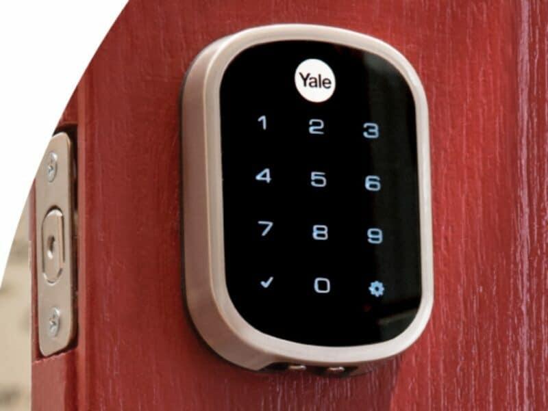 yale smart lock on an oak front door