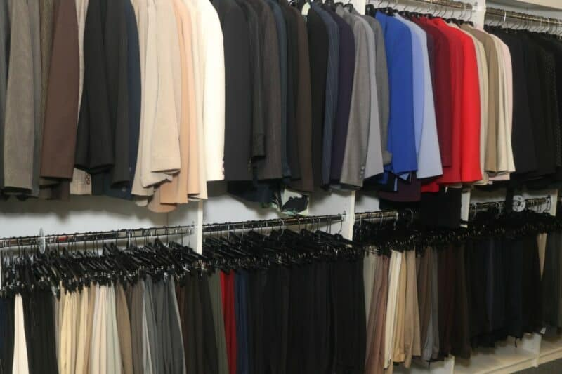 Attitudes and Attire boutique with an assortment of professional clothing hanging on hangers.