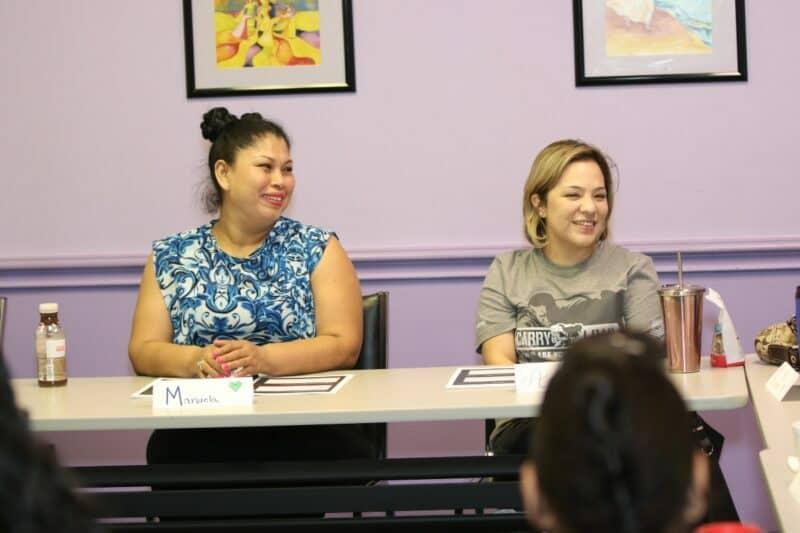 Attitudes and Attire participants sit in the organization's classroom.