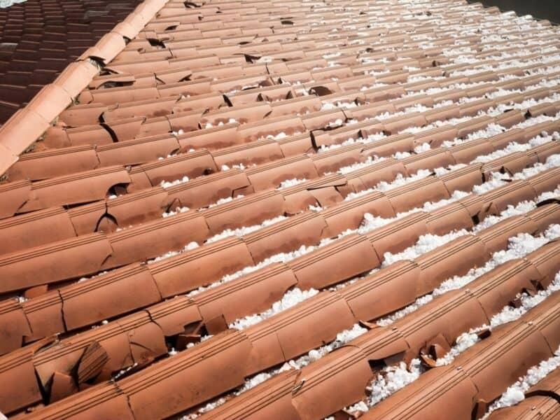 an orange roof with hail damage and remaining hail