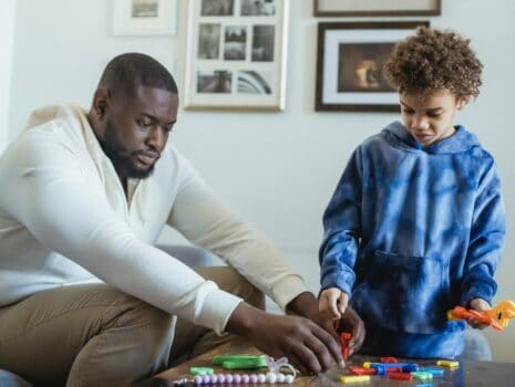 teaching a kid through toys and activities father and son