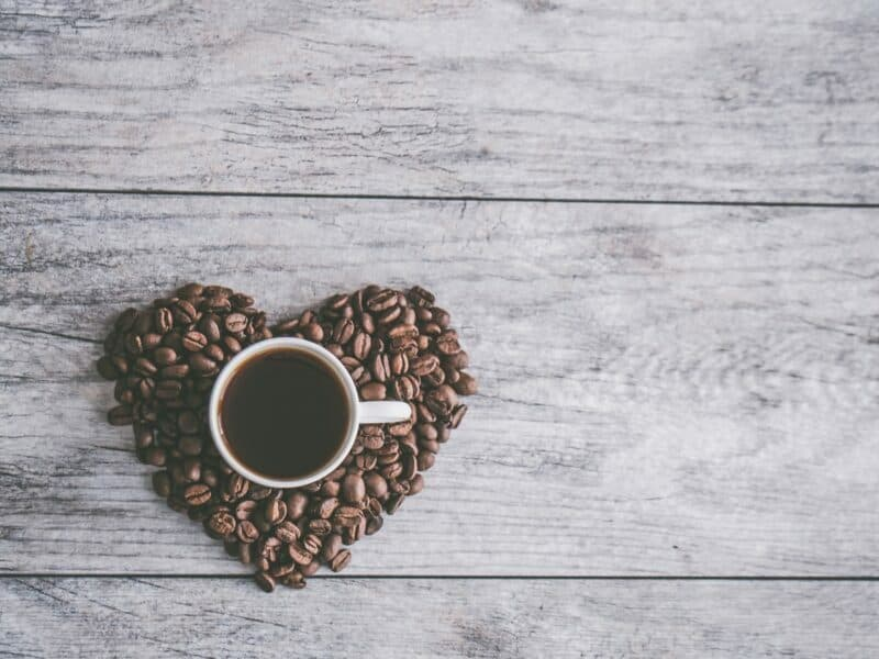 coffee beans in a heart around a coffee mug for couples coffee co, a dallas small business owned by a veteran