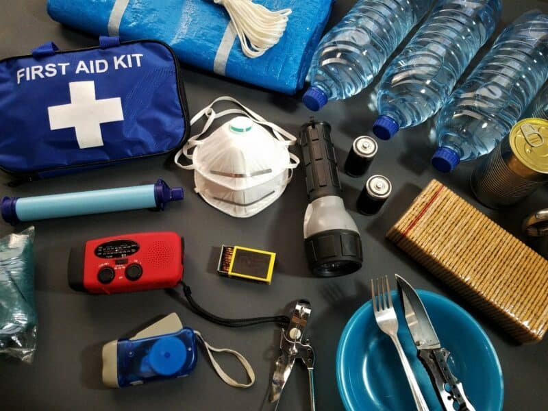 An emergency kit with miscellaneous items scattered across a surface.