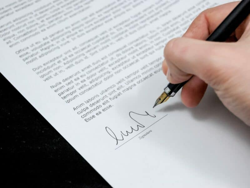 handwriting contract with pen