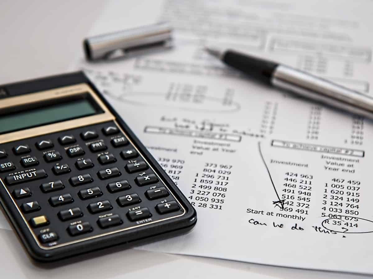 crunching numbers with a calculator for first time homebuyer