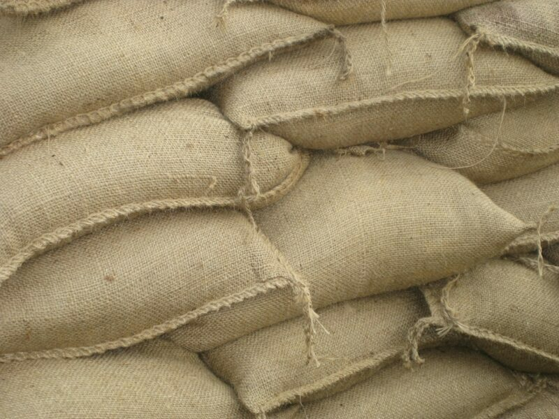 Sandbags stacked on top of one another.