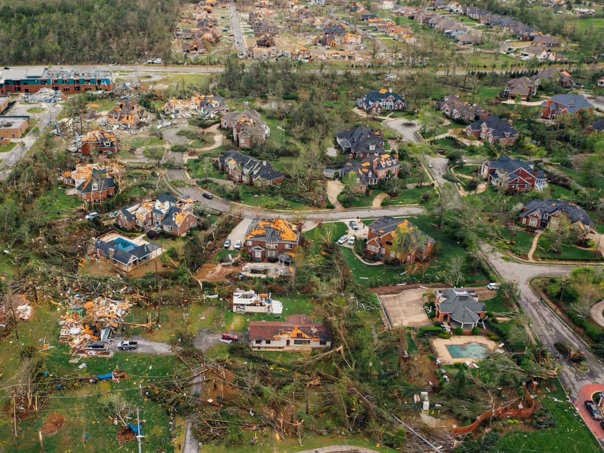 aftermath of a tornado pathway, destroyed homes