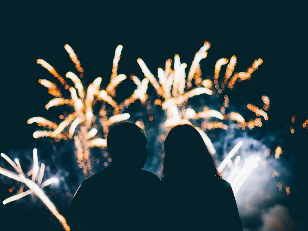 two people looking at fireworks